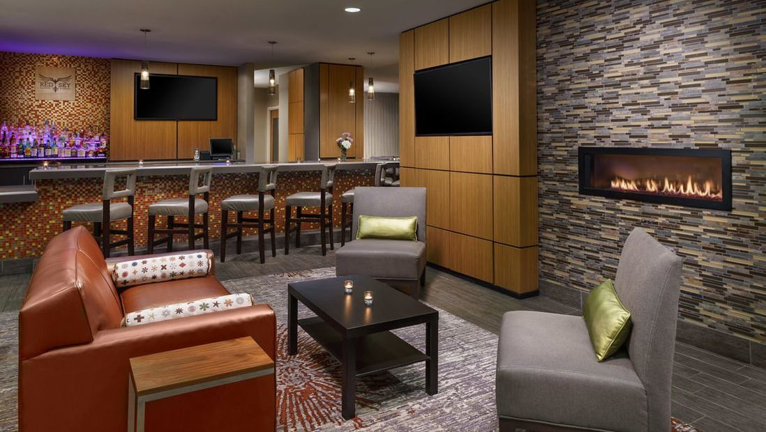 Enjoy dinner or a drink at Holiday Inn Charlotte University Red Sky Bar and Lounge
